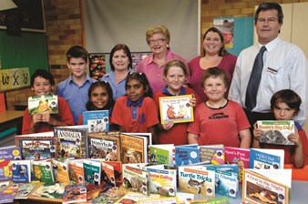Tamworth VIEW Club members donation books to their local Learning Club